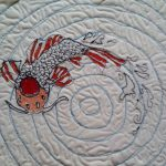 Free motion quilted koi carp