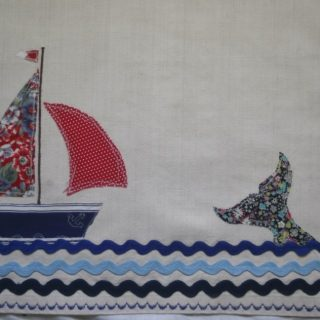 Sail and whale detail