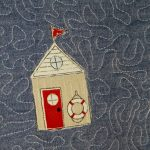 Organic cotton beach hut coffee cosy