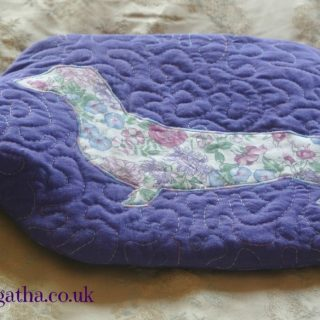 Purple dachshund hot water bottle cover