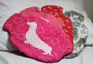 Snuggly hot water bottle covers