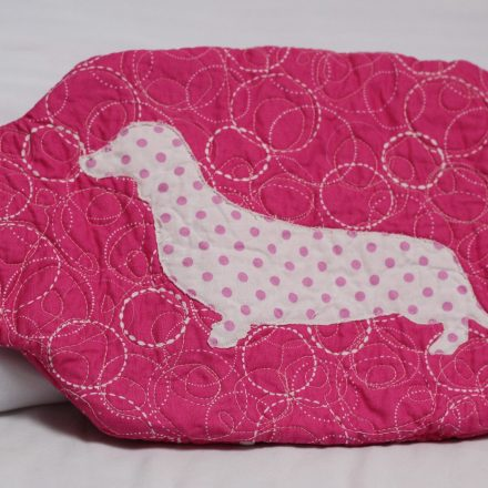 Circles and dots dachshund hot water bottle cover front